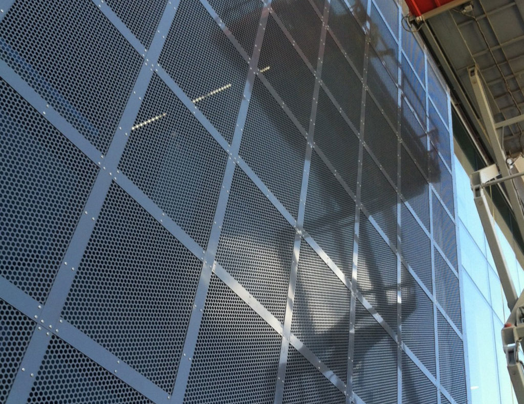 Perforated panels used for exterior walls and fences