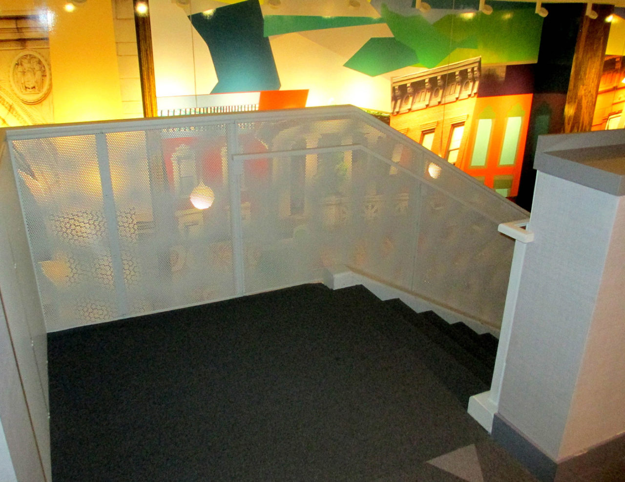 Custom railing systems with aluminum perforated panel infills