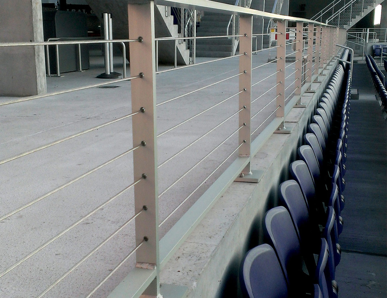 Top mounted Tensiline cable railing used along concourse walkway