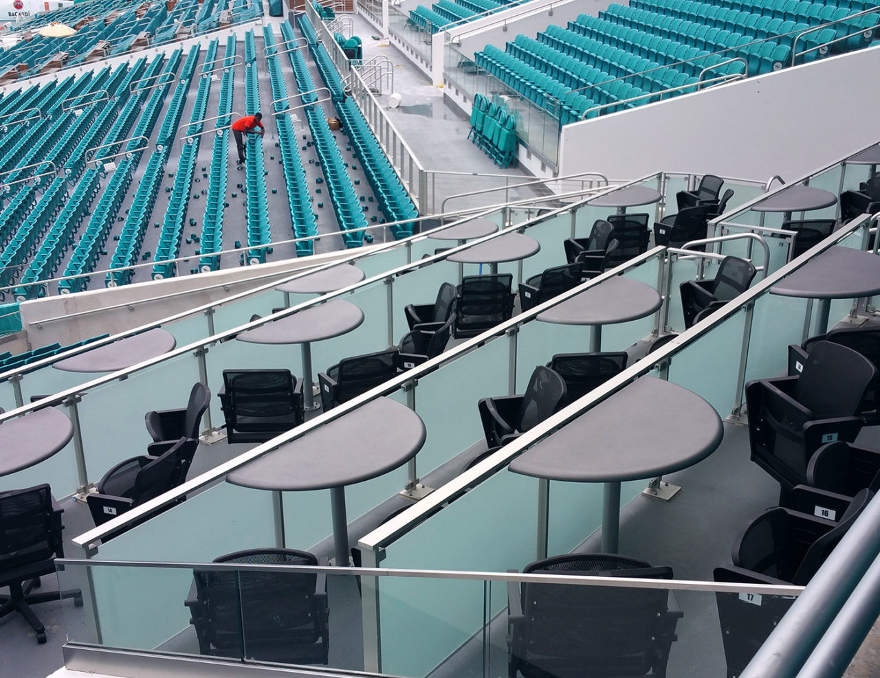 Post supported glass railing in suite areas
