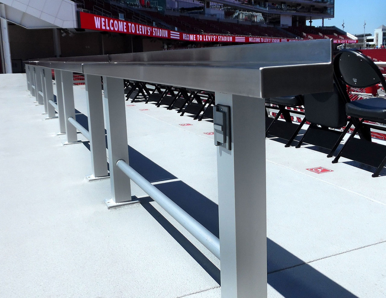 Custom USB-connected stainless steel drinkrails at upper and lower concourses of Levi's Stadium