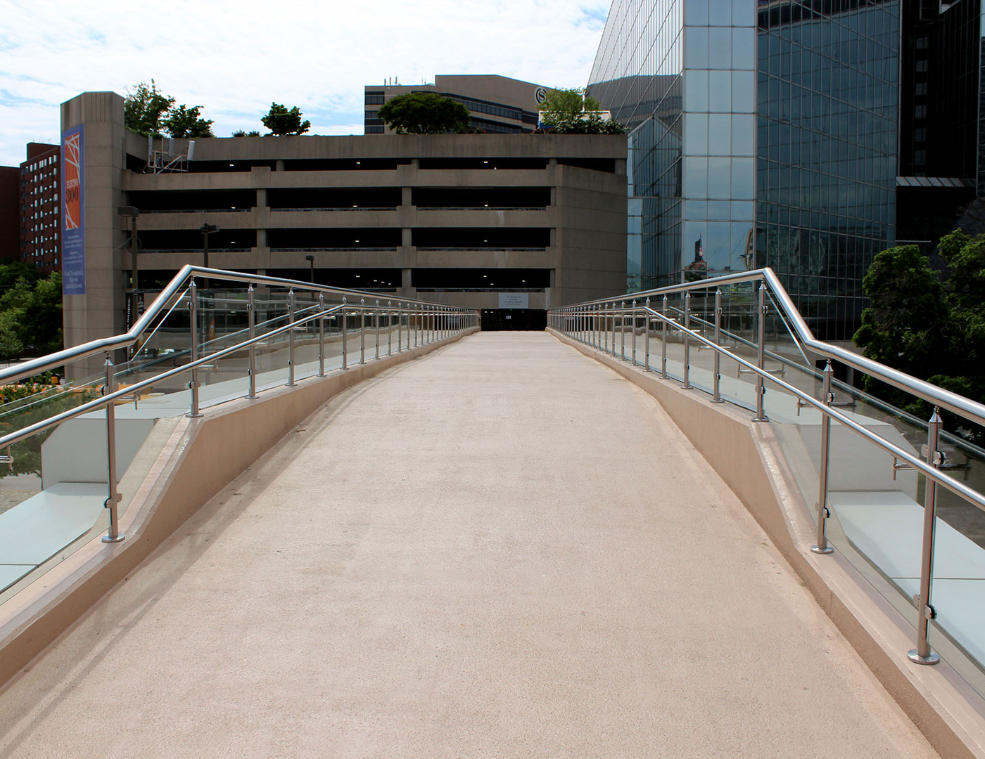 Exterior pedestrian bridge with glass railing