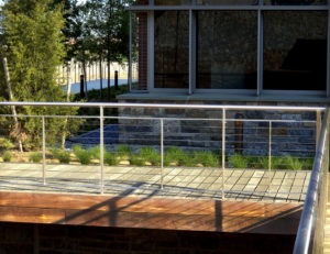 Stainless steel cable railing with custom frame and round handrail