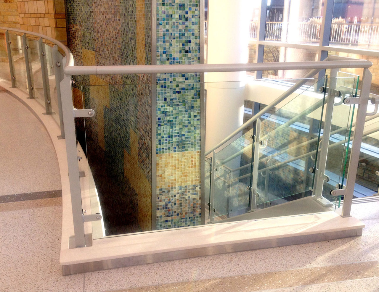 Healthcare facility with custom post supported glass railing