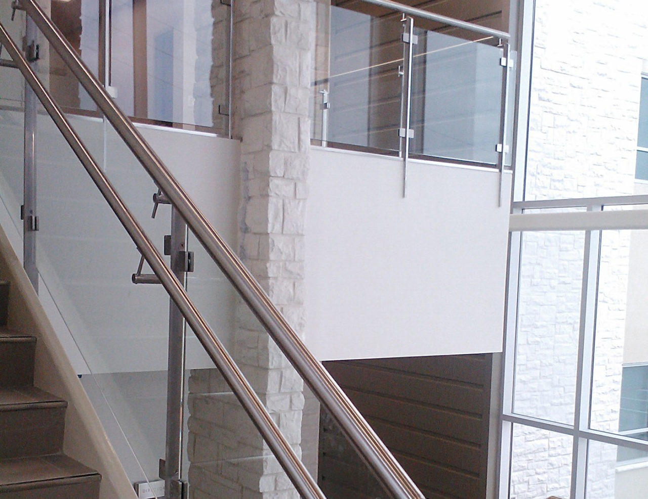 Summit railing system with stainless steel posts and glass infill