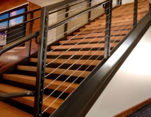 Interior Tensinline cable railing found on stairs in Stadium club areas.