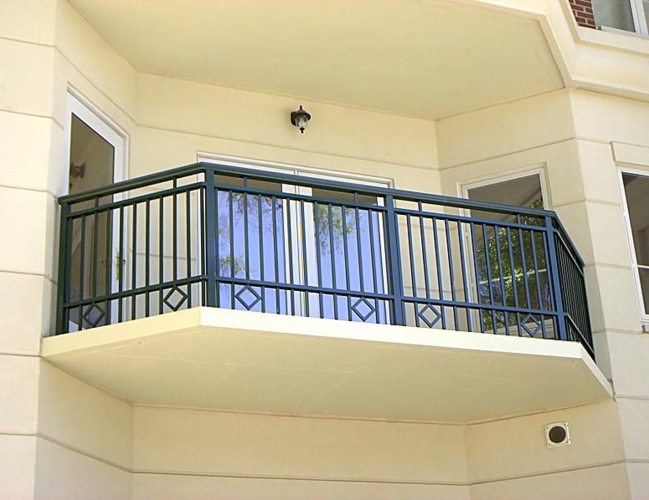 Exterior aluminum balcony railing with picket infill