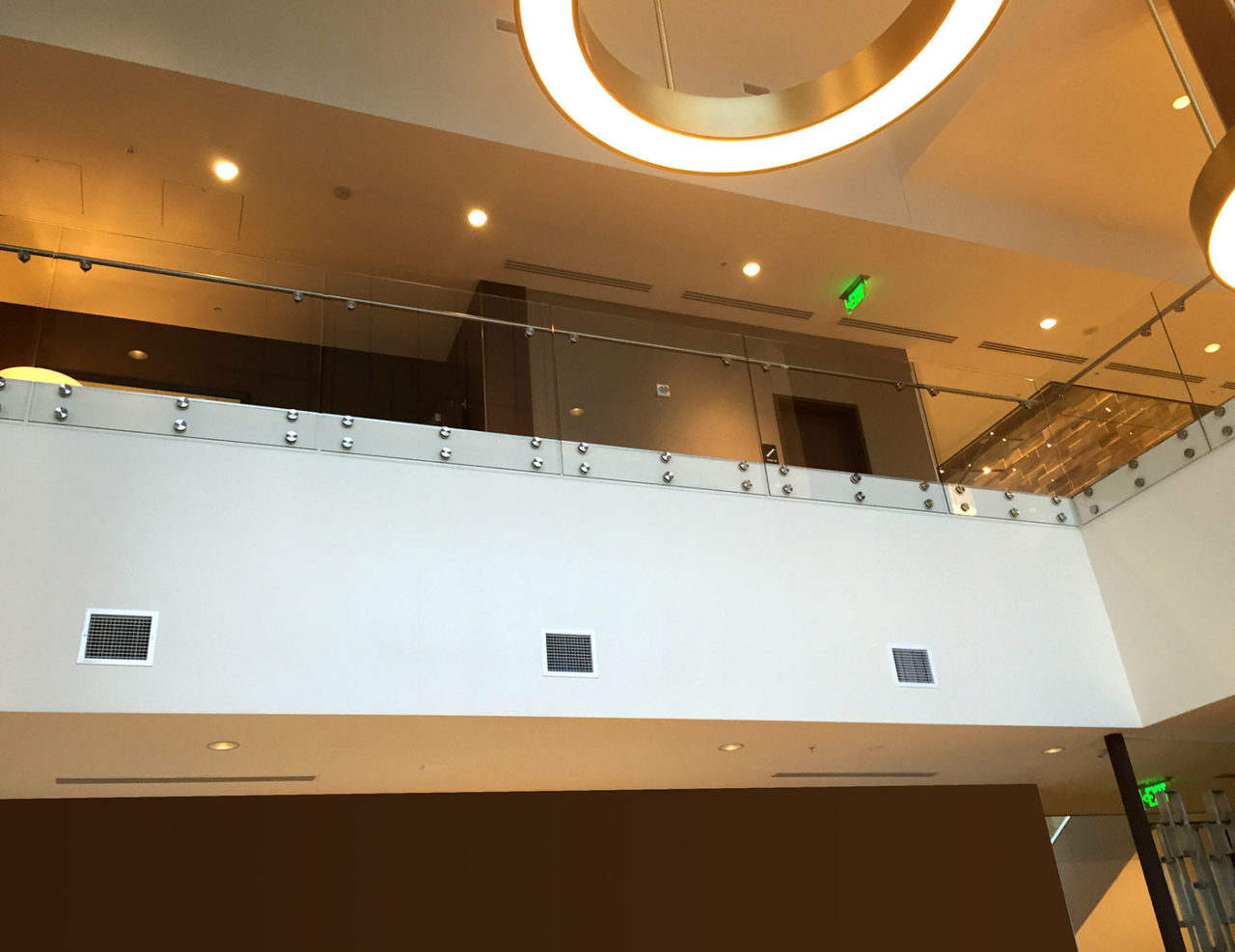 "Point series glass railing system features 2 1/2"" stainless steel side mounted nodes"