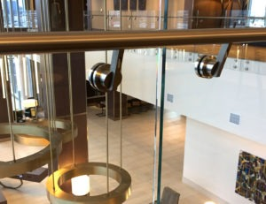 "36"" high stainless steel handrail with Point series standoffs"