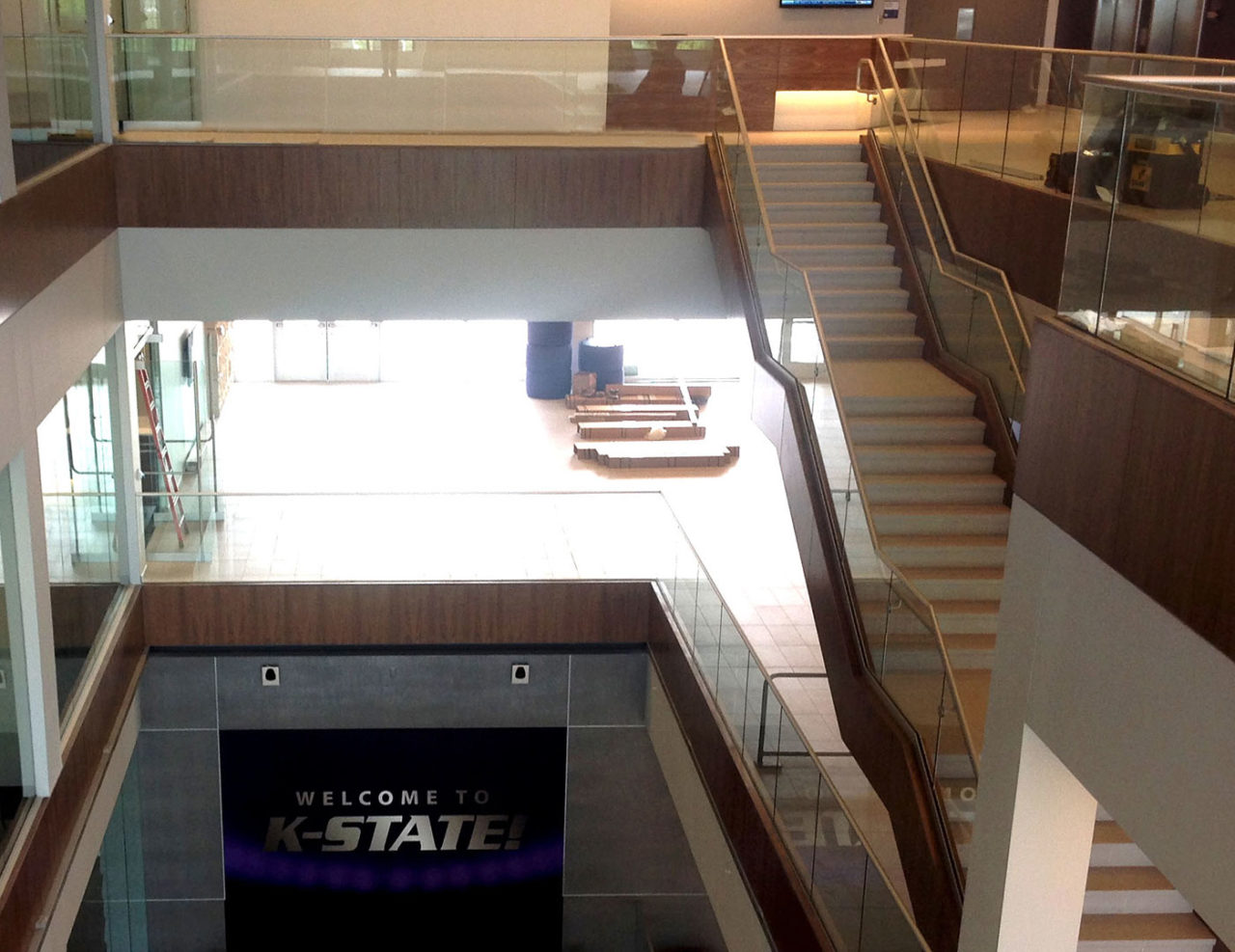 Base Shoe balcony glass railing in 4-story atrium
