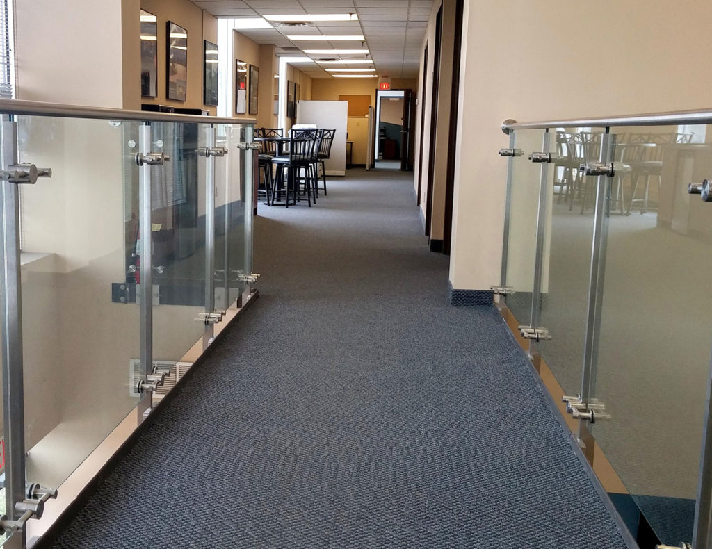 Line series post supported glass railing