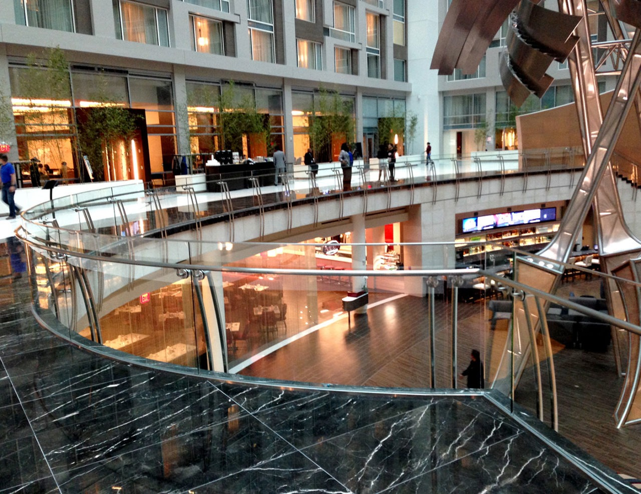 Custom Track Rail glass railing with stainless steel stanchions