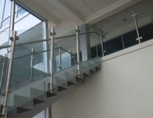 Side mounted Monaco glass railing with D-shaped glass clamps
