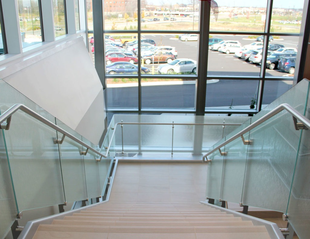 Side mounted Dot glass railing with handrail