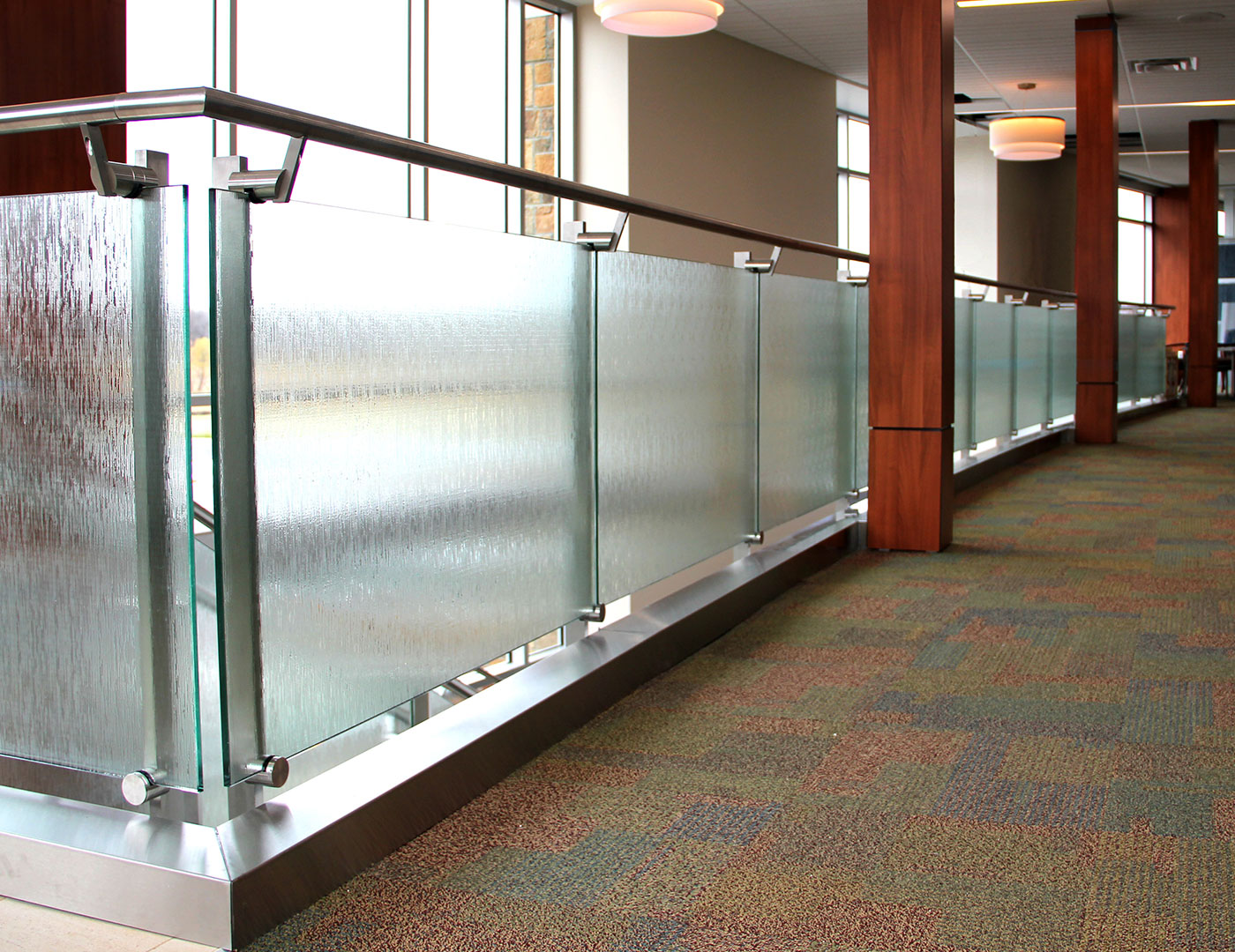 Side mounted post supported glass railing