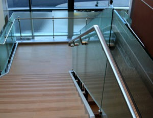 Glass railing with stainless steel handrail