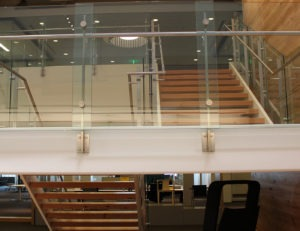 Overlapping glass panels with our Summit railing system