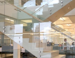 Point series glass railing utilized on multilevel staircases