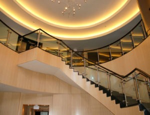 Southpark glass railing with top cap adds elegance to lobby