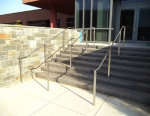 Stainless steel tube handrail with custom stainless steel flat bar posts