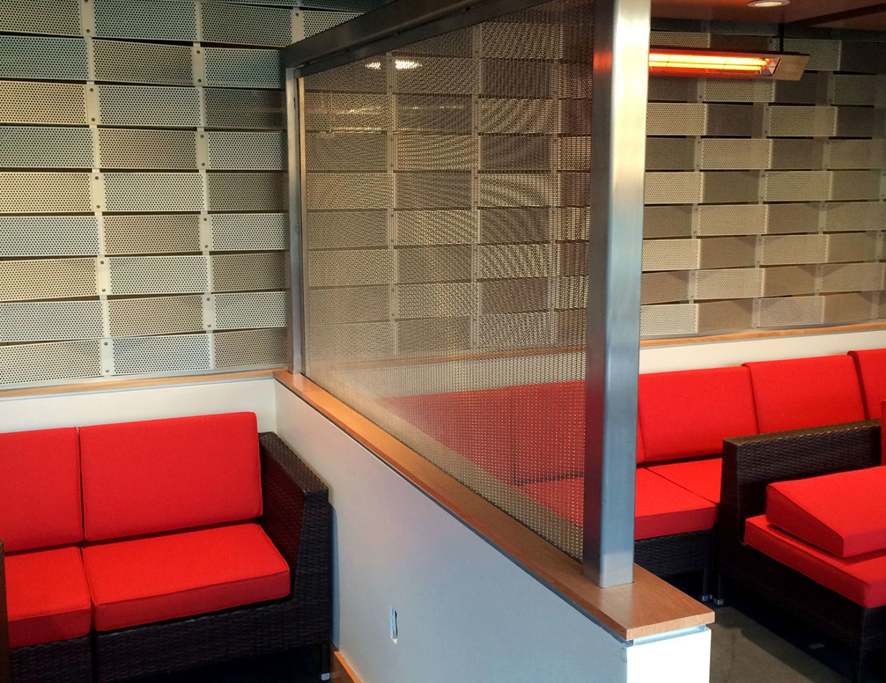 Custom stainless steel mesh partitions between suite areas