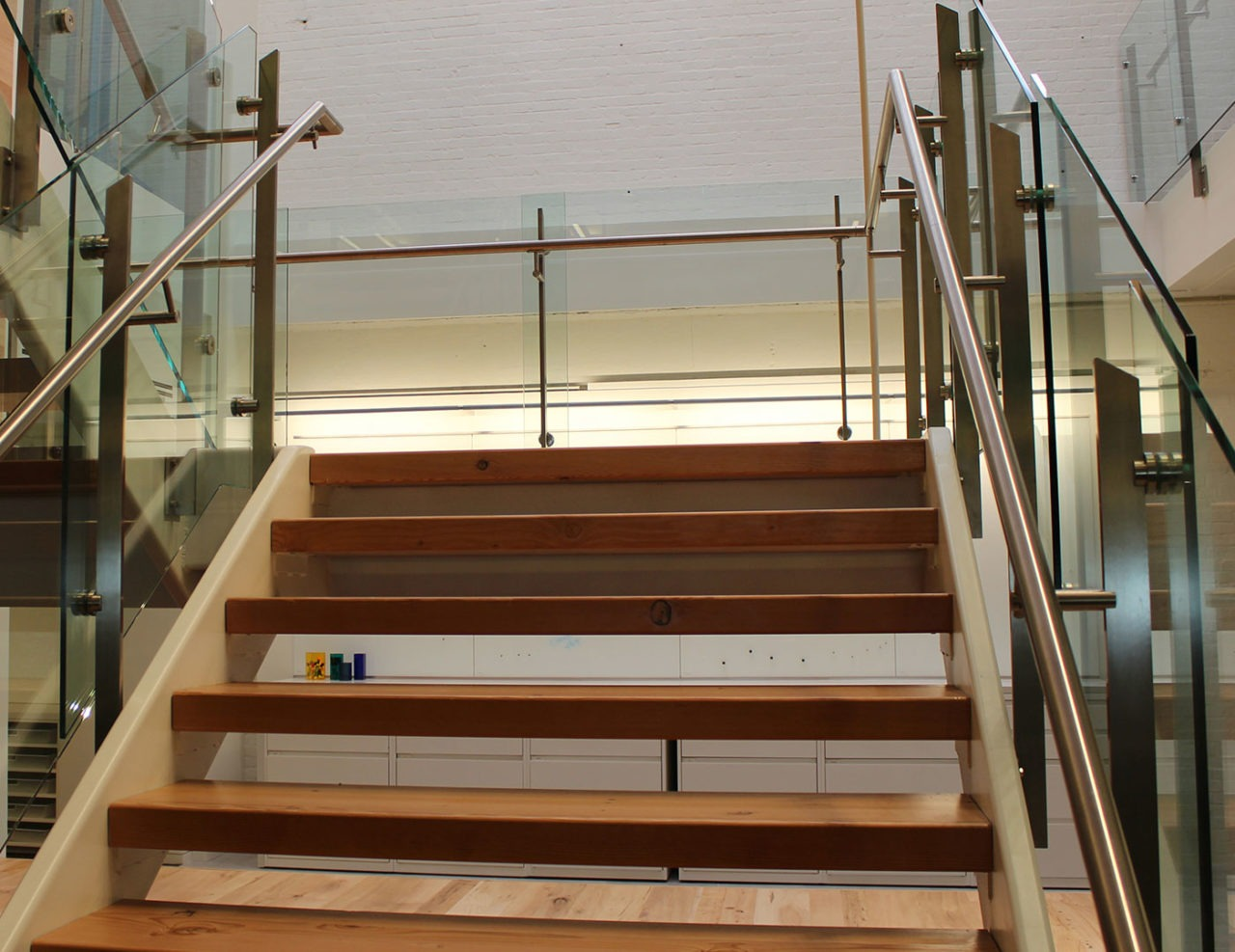 Post-mounted stainless steel handrails are used throughout the Summit railing system
