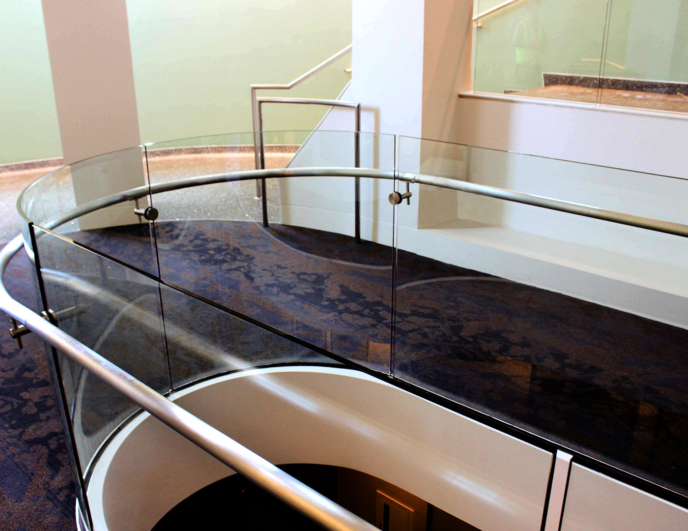 Base shoe glass railing with rolled glass