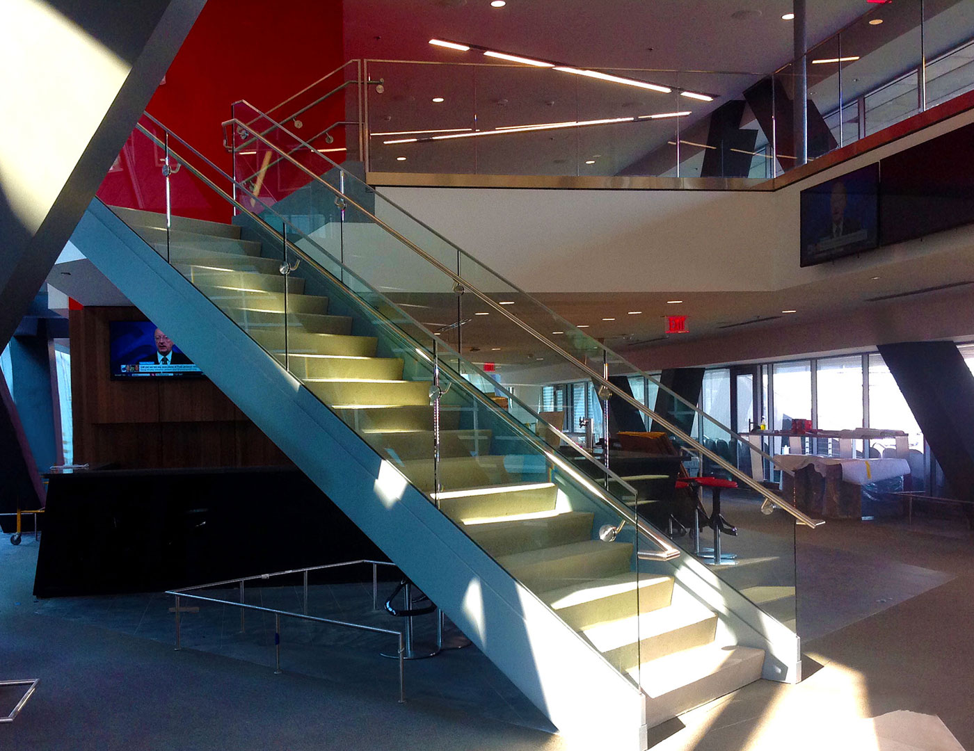 Glass railing was used on stairs and balcony