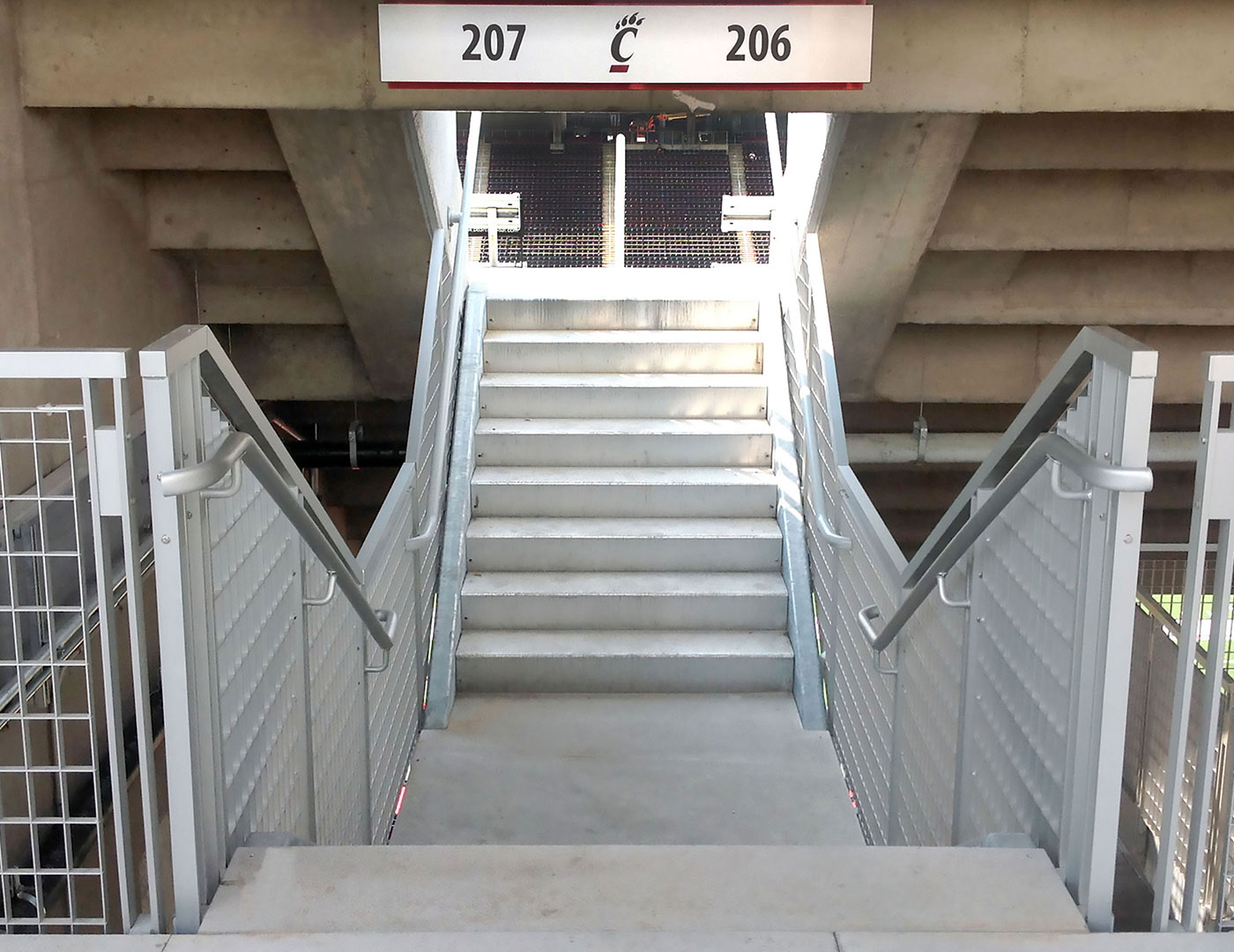 Gridguard grated railing on elevated bridges at college football stadium