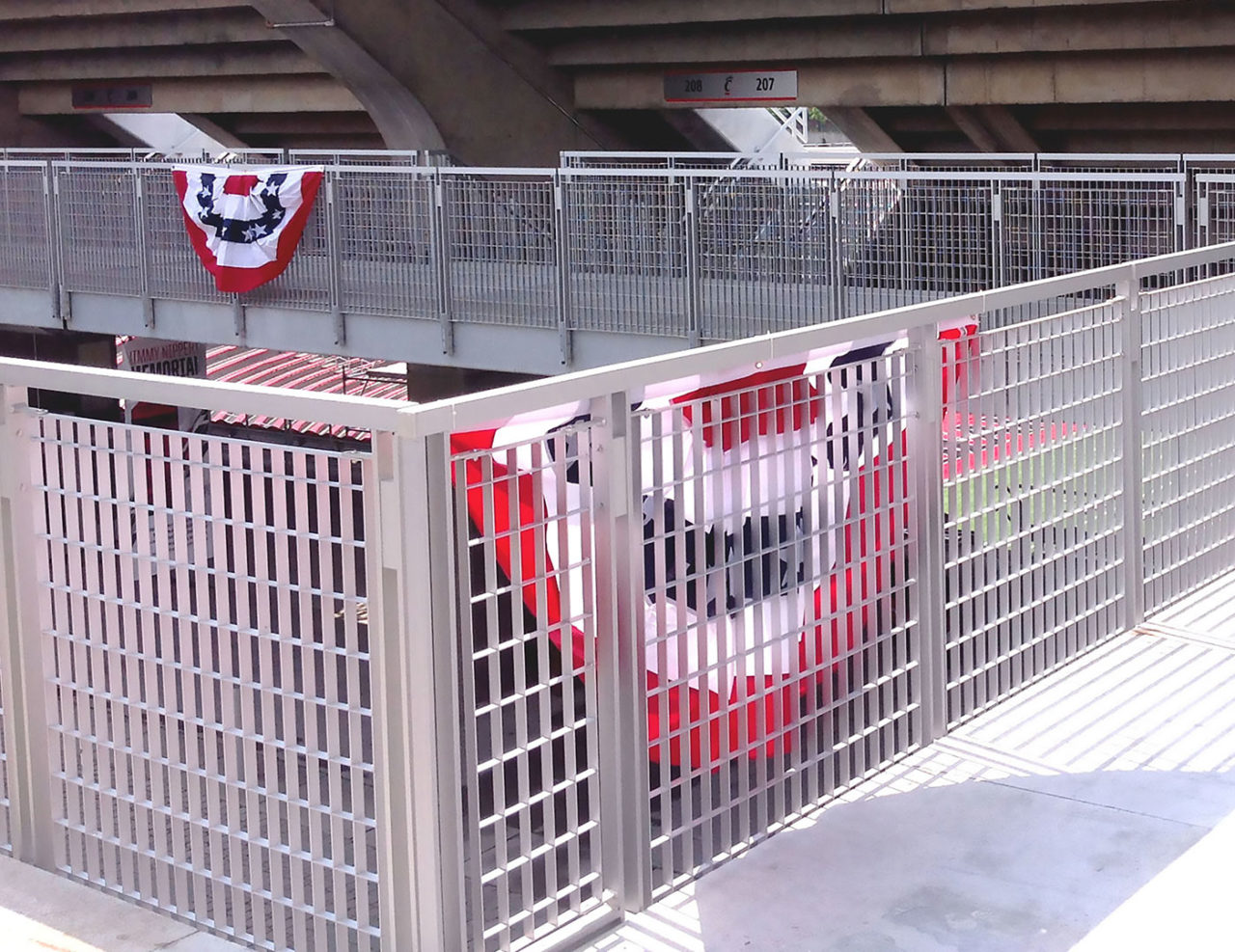 Gridguard grated railing on elevated walkways at college football stadium