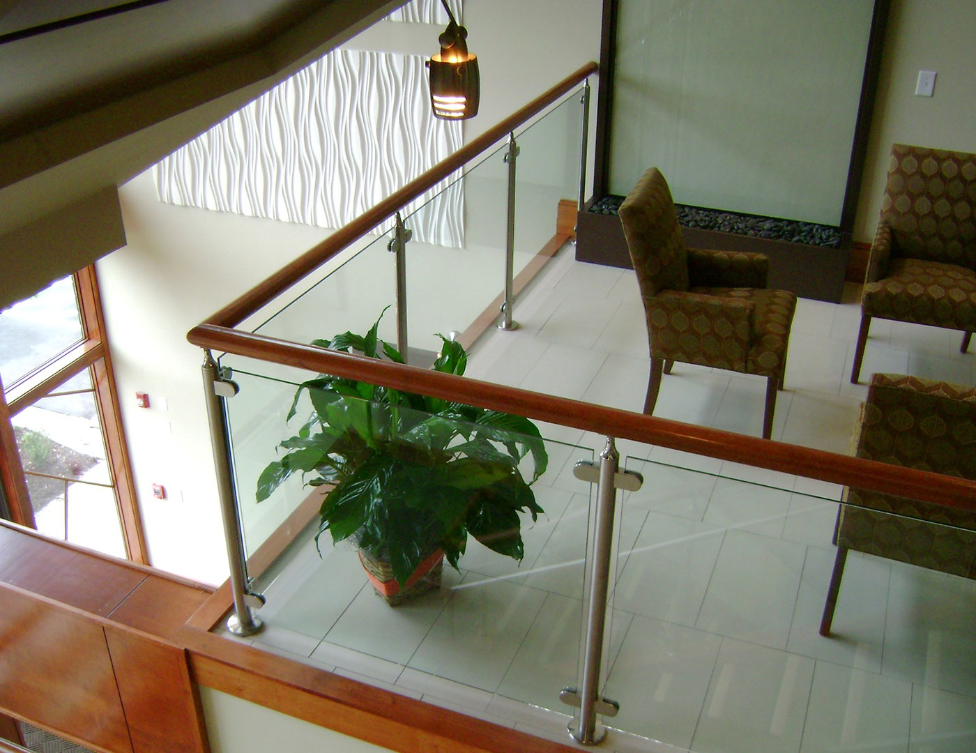 Glass railing with wood top cap