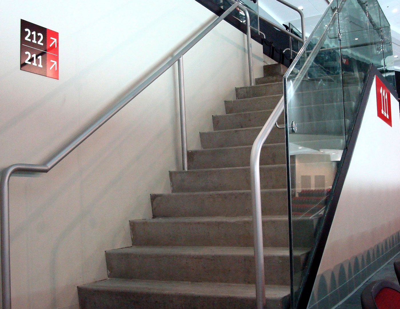 Arena using aluminum handrail with our Track Rail glass railing system