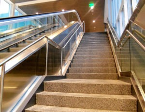 Metal handrail complimenting glass railing