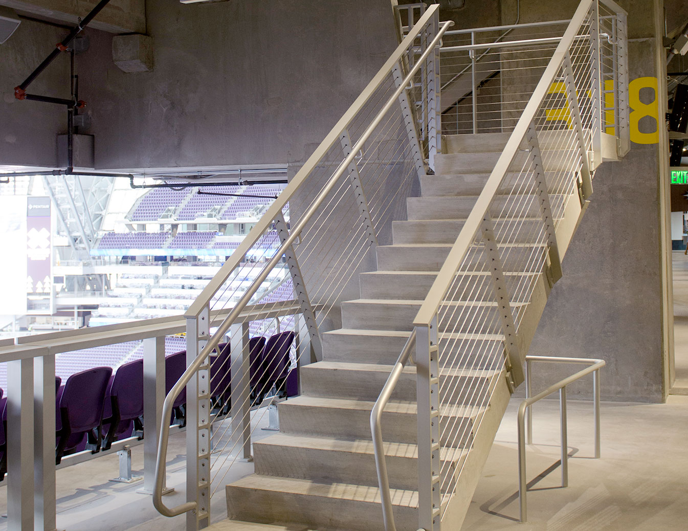Tensiline cable railing used on fan entrance stairs from concourse areas