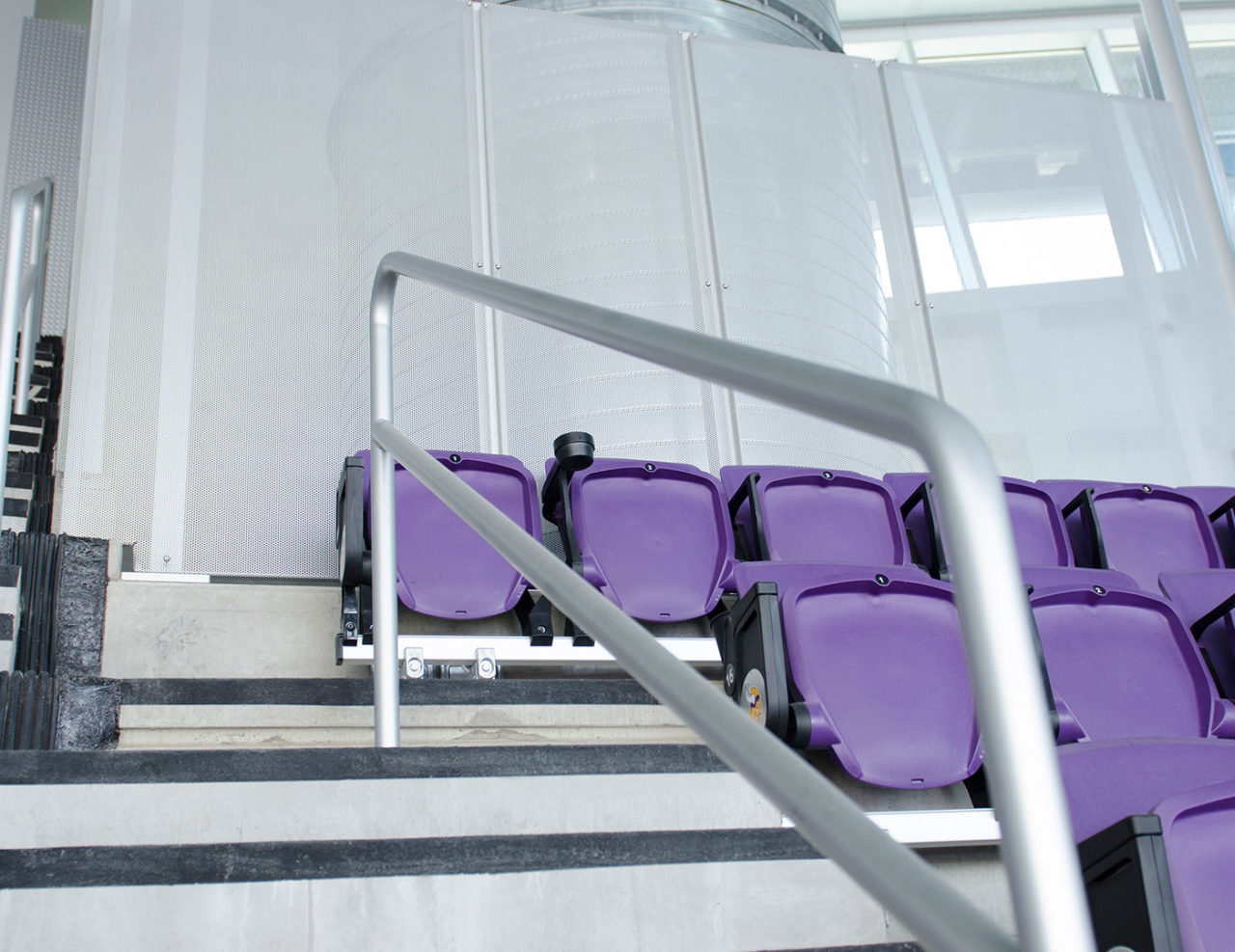 Perforated panels line the perimeter of the upper seating bowl
