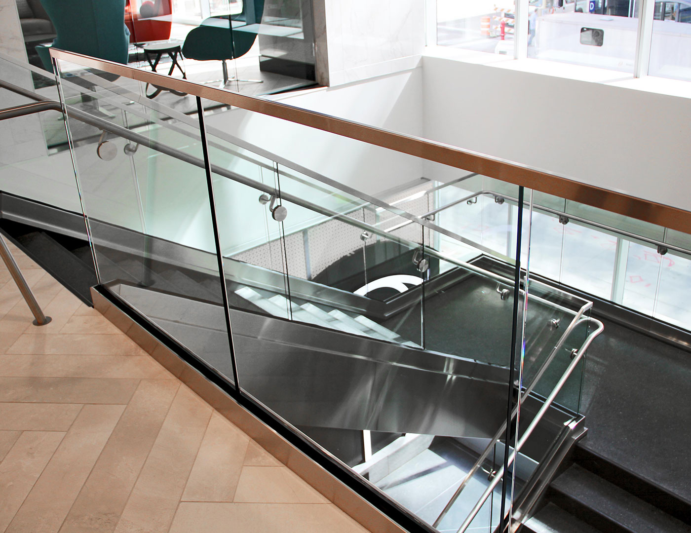 Multiple stairs and overlooks utilized the dry glaze Track Rail glass railing system.
