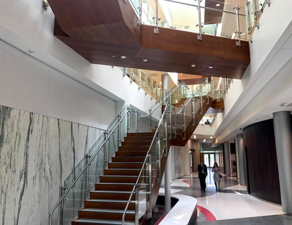 Luxor's distinctive details punctuate a truly unique glass railing application throughout the stairs and overlooks within the atrium area