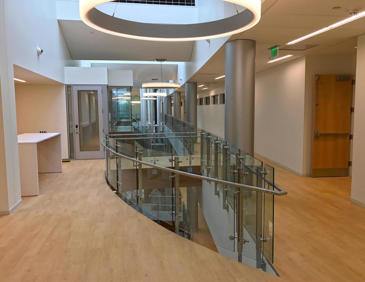 Overlooks feature a radius glass railing application with post-mounted stainless handrail