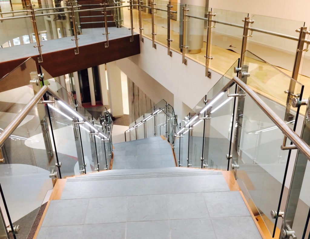 Sacred Heart University featuring Luxor glass guardrail, our double-bar post and glass railing design.