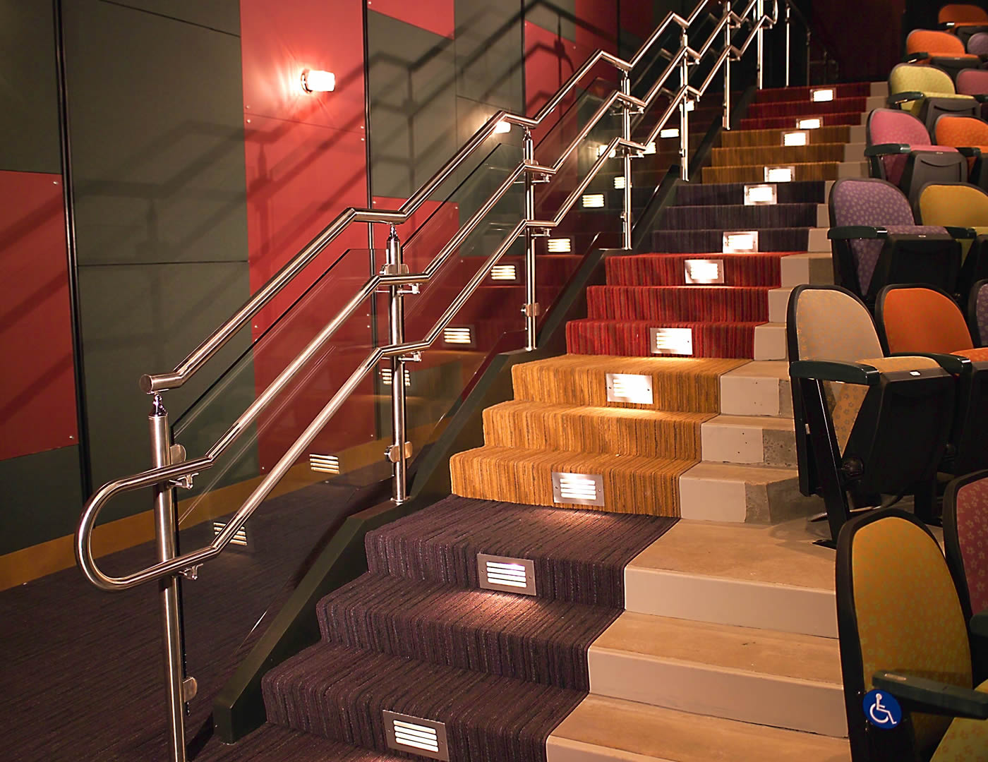 Lines of the top cap, glass, and handrail mimic the line of the stringer on this Monaco glass railing system.