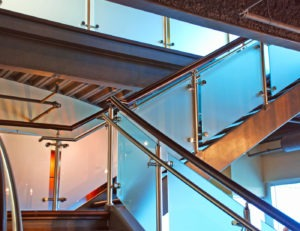 Glass railing with semi-opaque, frosted glass still allows for the passage of light.