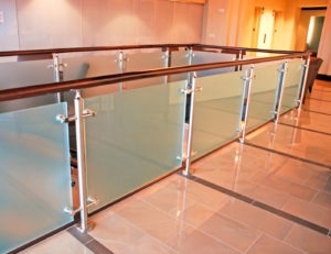 The landing hosts glass railing with an embedded post mounting application, with cover plates.