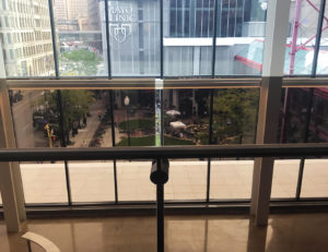 Post mounted stainless steel handrail with Dot series standoffs are featured on the lobby overlooks glass guardrail