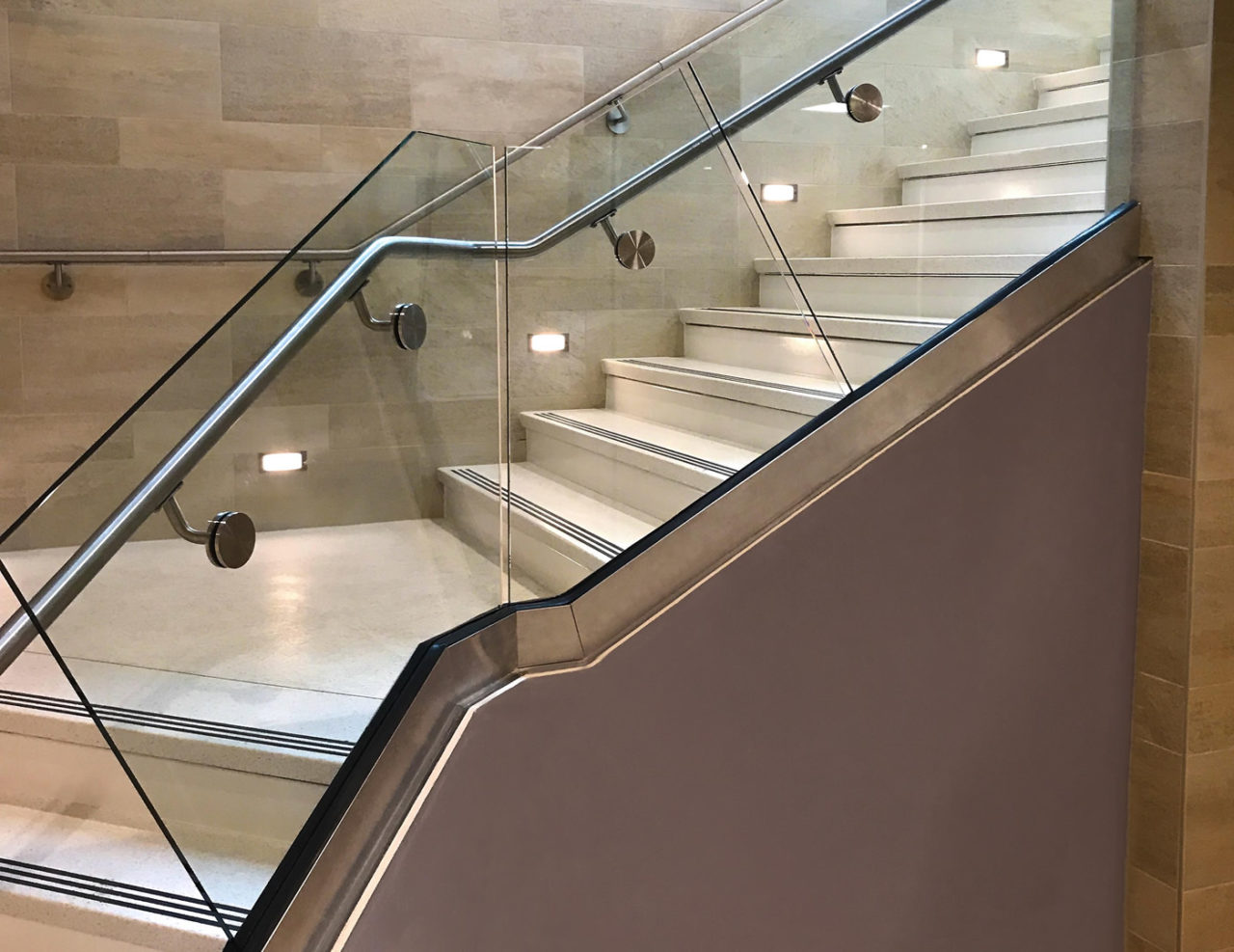 Specially-formed glass was provided for the stair installation of our Track Rail glass railing system.