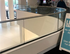 Specialty bent glass and stainless steel top cap was utilized for Track Rail on glass guardrail overlooks.