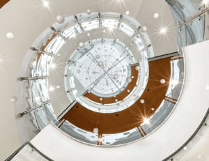 Glass railing offers flexibility in that the system may be used in radius applications.