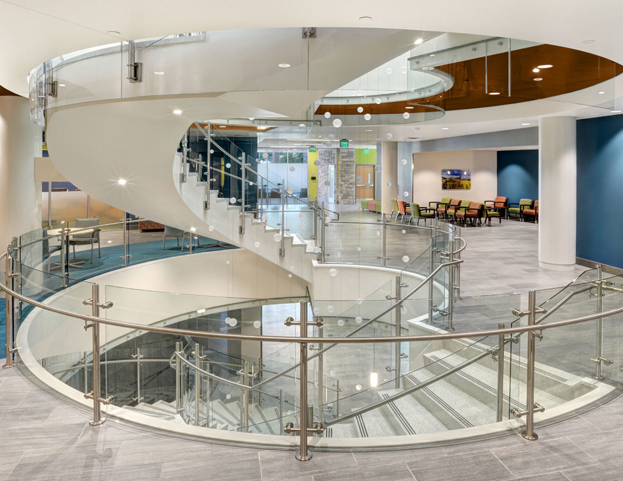 Trex Commercial Products' Vista glass railing provides the perfect accompaniment to the building's circular staircase and overlooks without distracting from the distinctive architectural details and cascading art installation.