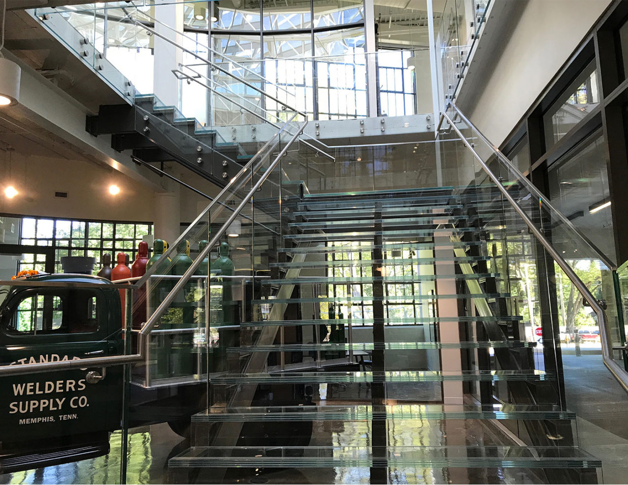 Office Lobby glass railing, glass stair treads