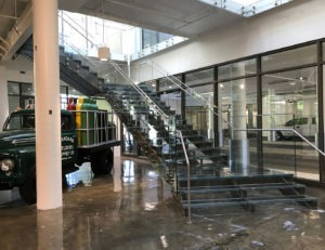 Corporate headquarters lobby, glass railing, glass stairs
